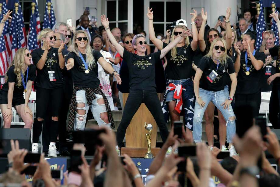 The U.S. women's soccer team, with Megan Rapinoe, at center, is celebrated at City Hall after a ticker tape parade, Wednesday, July 10, 2019, in New York. The U.S. national team beat the Netherlands 2-0 to capture a record fourth Women's World Cup title. Photo: Seth Wenig / Associated Press / Copyright 2019 The Associated Press. All rights reserved.