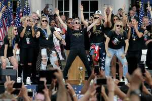 The U.S. women's soccer team, with Megan Rapinoe, at center, is celebrated at City Hall after a ticker tape parade, Wednesday, July 10, 2019, in New York. The U.S. national team beat the Netherlands 2-0 to capture a record fourth Women's World Cup title.
