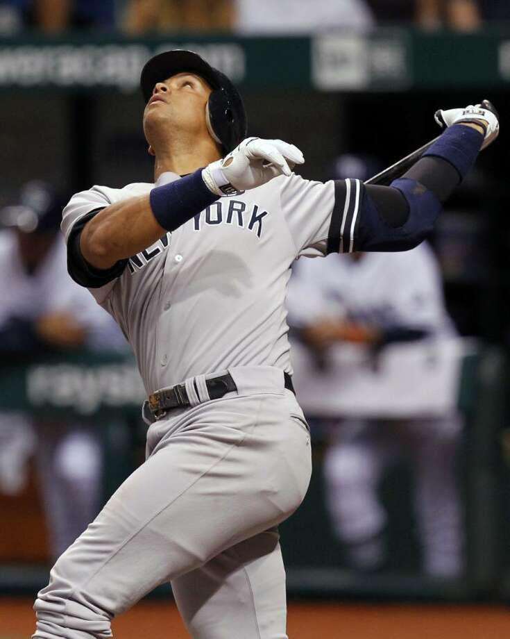 New York Yankees' Alex Rodriguez pops up in the sixth inning of a baseball game against the Tampa Bay Rays, Friday, July 30, 2010, in St. Petersburg, Fla. (AP Photo/Mike Carlson) Photo: AP