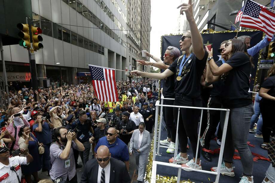 The U.S. women's soccer team, including Megan Rapinoe (far left on float), is celebrated with a parade along the Canyon of Heroes on Wednesday in New York. Photo: Richard Drew / Associated Press
