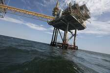 FILE - In this Tuesday, April 27, 2010 file photo, An oil rig is seen in the Gulf of Mexico near the Chandeleur Islands, off the Southeastern tip of Louisiana. Energy companies have reoccupied nearly 400 of the production platforms in the Gulf of Mexico that were abandoned in advance of Hurricane Isaac, though oil production remains almost entirely shut down. Oil and gas workers began retaking the offshore sites Friday and federal officials on Saturday, Sept. 1, 2012 say that 377 of the 596 productions platforms have some staffing on them, up from just 97. (AP Photo/Gerald Herbert, File)