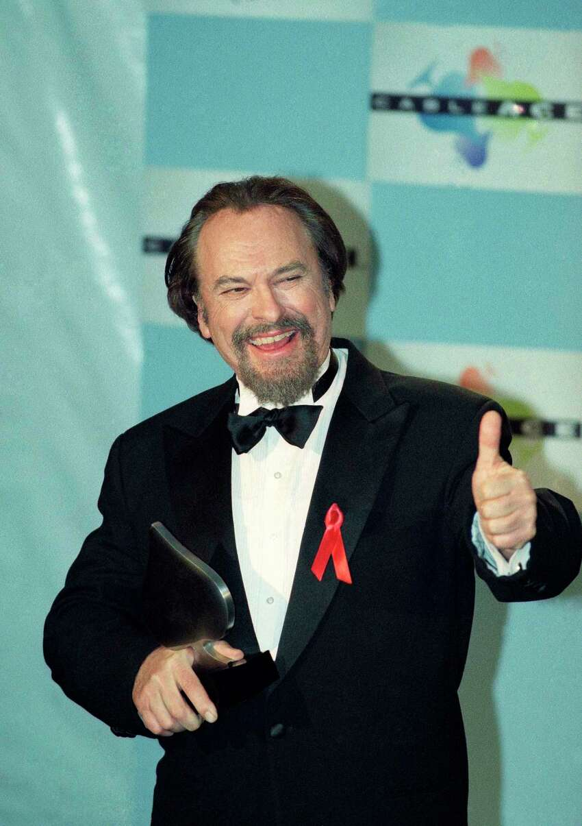 FILE - In this Jan. 15, 1995, file photo, actor Rip Torn gives a thumbs-up to photographers after winning for Best Actor in a Comedy Series for HBO's