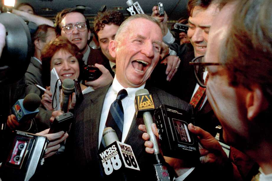 "FILE - This May 5, 1992 file photo shows Texas billionaire Ross Perot laughing after saying ""Watch my lips,"" in response to reporters asking when he plans to formally enter the presidential race. Perot, the colorful, self-made Texas billionaire who rose from a childhood of Depression-era poverty and twice ran for president as a third-party candidate, has died. He was 89. (AP Photo/Richard Drew. File) Photo: RICHARD DREW / Copyright 2019 The Associated Press. All rights reserved."