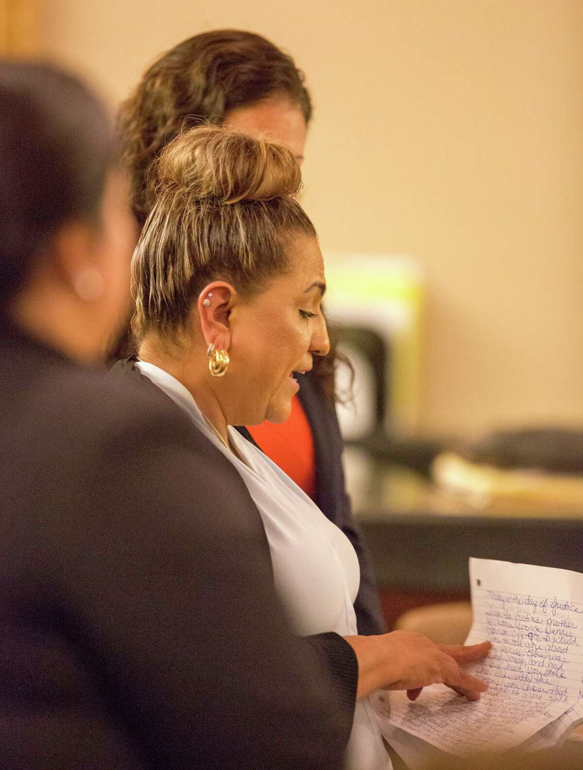 Dorthy Castro, mother of a victim killed by Brian Flores speaks her final words to him in court, Wednesday, July 10, 2019, at Cadena-Reeves Justice Center in San Antonio. Flores is charged with Capital Murder and chose to a sentence to spend life in prison over the death penalty. Rebecca Slezak/Staff photographer