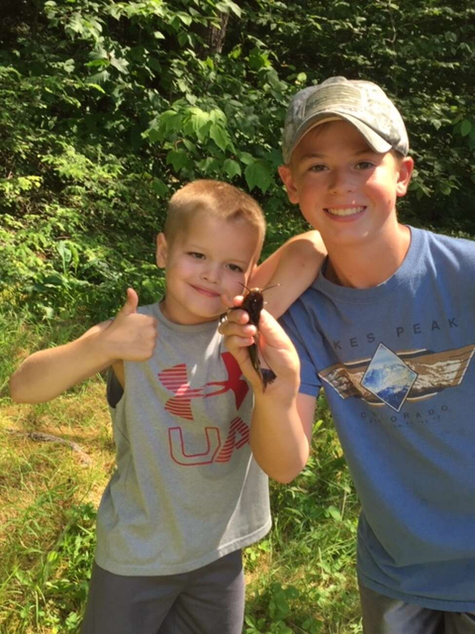 Nicholas Borden, 7, and Owen Wallen, 12, of Wynantskill with their catch of the day at Cherry Plain State Park.