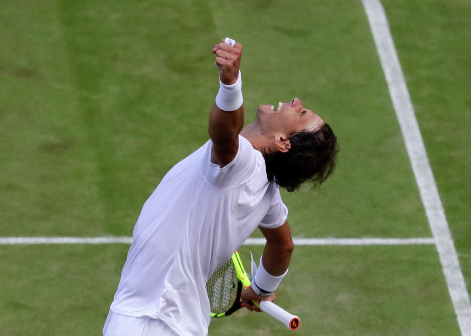 Spain's Rafael Nadal celebrates winning a men's quarterfinal match against United States' Sam Querrey on day nine of the Wimbledon Tennis Championships in London, Wednesday, July 10, 2019. (AP Photo/Kirsty Wigglesworth) Photo: Kirsty Wigglesworth / Copyright 2019 The Associated Press. All rights reserved