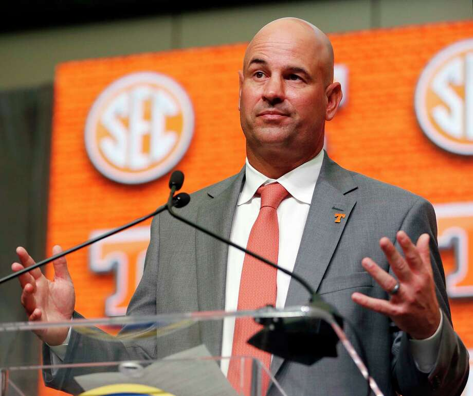 FILE - In this July 18, 2018, file photo, Tennessee NCAA college football head coach Jeremy Pruitt speaks during Southeastern Conference Media Days in Atlanta. Pruitt committed a minor NCAA violation earlier this year by tweeting out his congratulations when the high school he attended won an Alabama state basketball title. The tweet was deleted 37 minutes later, after a compliance official noted that it constituted an impermissible endorsement of a high school team and its coach. (AP Photo/John Bazemore, File) Photo: John Bazemore / Copyright 2018 The Associated Press. All rights reserved.