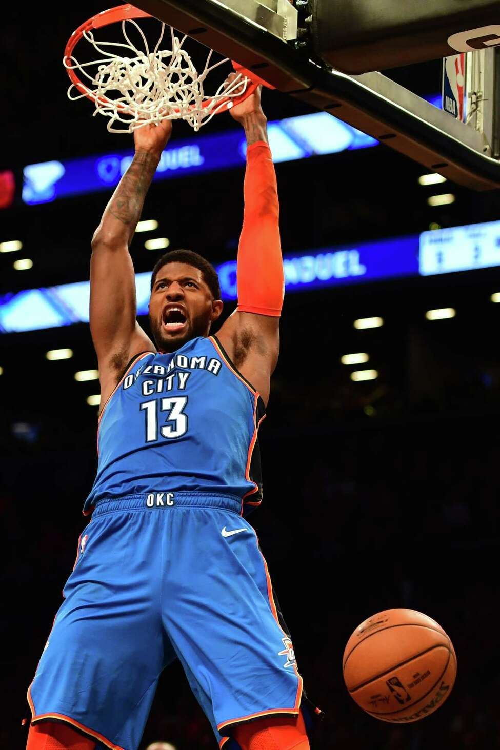 NEW YORK, NEW YORK - DECEMBER 05: Paul George #13 of the Oklahoma City Thunder reacts after making a slam dunk during the fourth quarter of the game against Brooklyn Nets at Barclays Center on December 05, 2018 in New York City. NOTE TO USER: User expressly acknowledges and agrees that, by downloading and or using this photograph, User is consenting to the terms and conditions of the Getty Images License Agreement. (Photo by Sarah Stier/Getty Images)