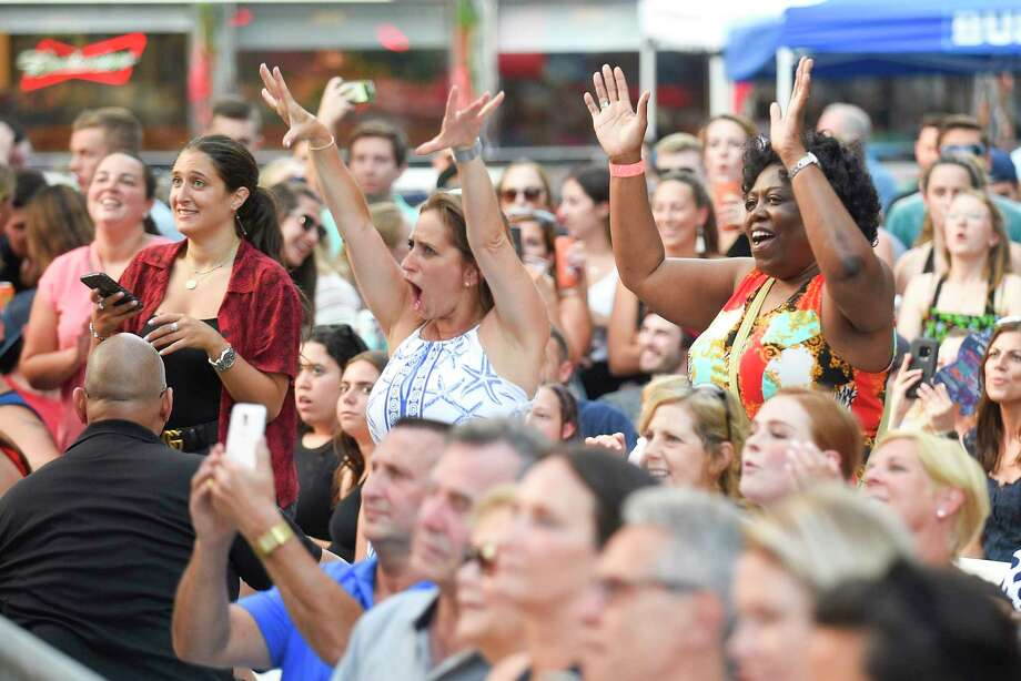 "Concert fans dance to Andy Grammer's hit song ""Don't Give Up On Me"" as he performs at the Wednesday Nite Live in Stamford, Conn. on July 10, 2019. Hundreds of music fans packed into Stamford's Columbus Park to enjoy Grammer and the opening band Raquel and The Wildflowers, as they kicked off to the annual summer concert series. Photo: Matthew Brown, Hearst Connecticut Media / Stamford Advocate"