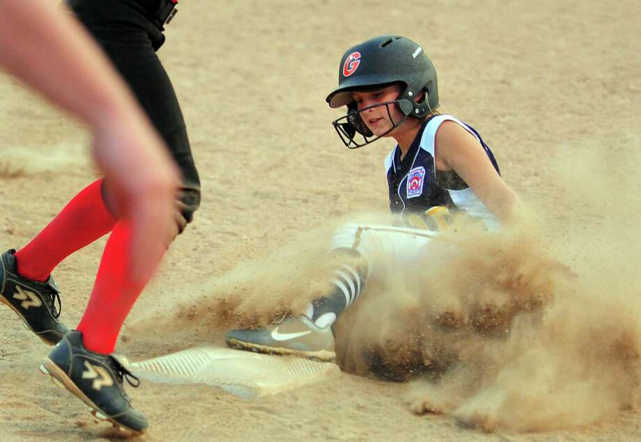 Milford's Haley Stroffolino (10) slides into third base during Section 1 Little League softball final action against Fairfield in Orange, Conn., on Wednesday July 10, 2019. Photo: Christian Abraham / Hearst Connecticut Media / Connecticut Post