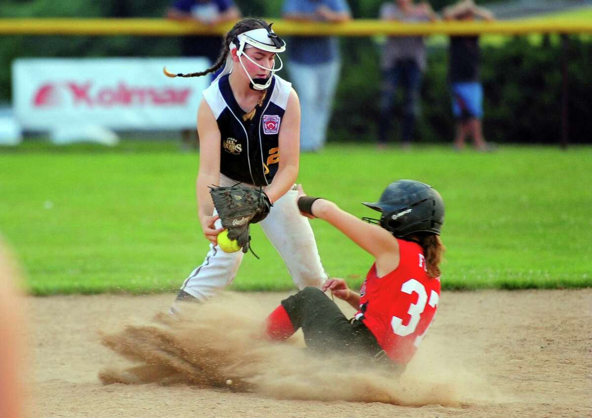 Milford's Madison Bull (12) tags out Fairfield's Lavren Foley at second during the Section 1 Little League softball final on Wednesday in Orange.