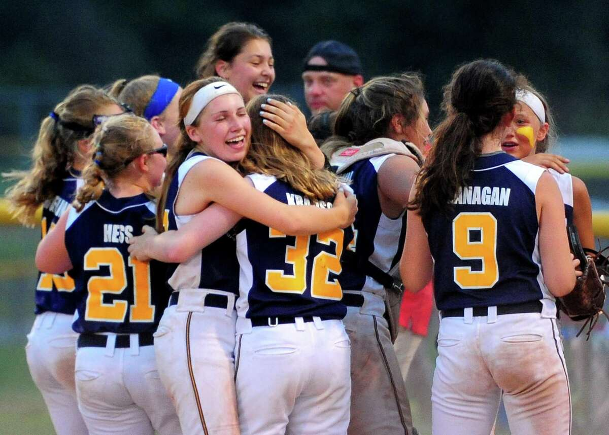 Milford celebrates its win over Fairfield during Section 1 Little League softball final action in Orange, Conn., on Wednesday July 10, 2019.