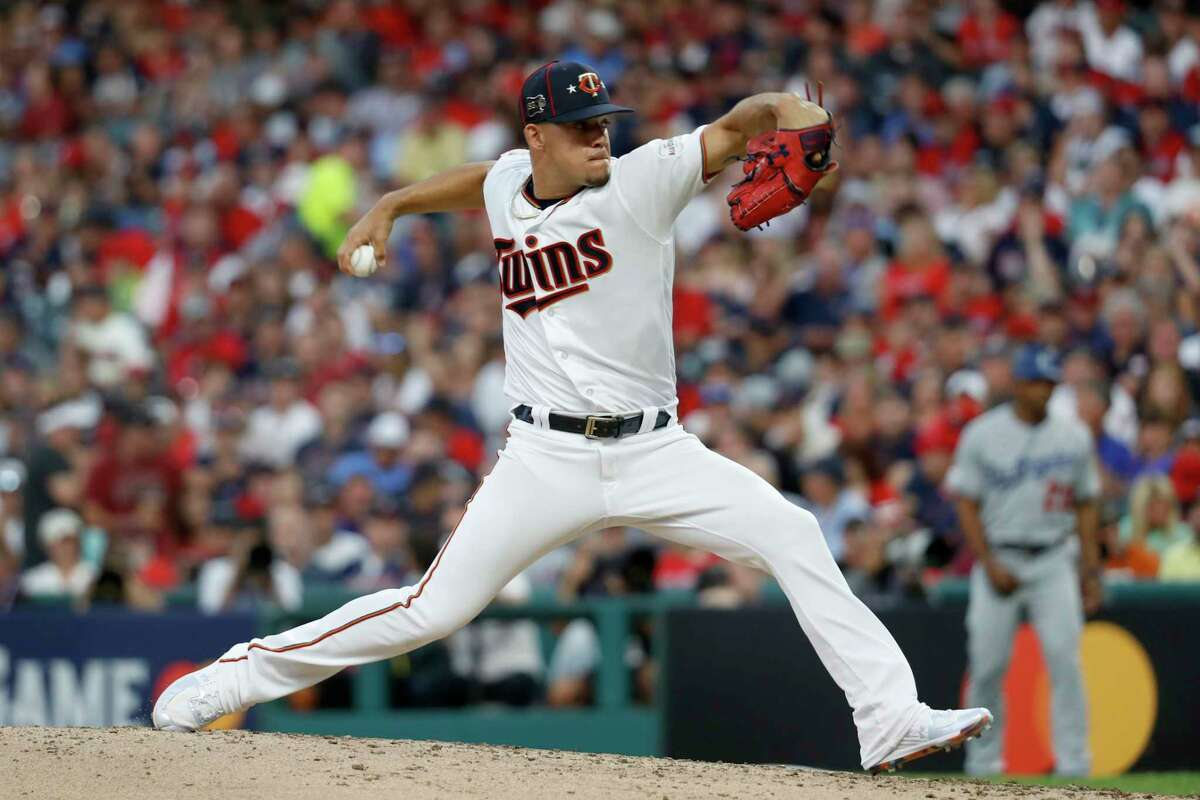 American League pitcher Jose Berrios, of the Minnesota Twins, throws during the third inning of the MLB baseball All-Star Game against the National League, Tuesday, July 9, 2019, in Cleveland. (AP Photo/John Minchillo)