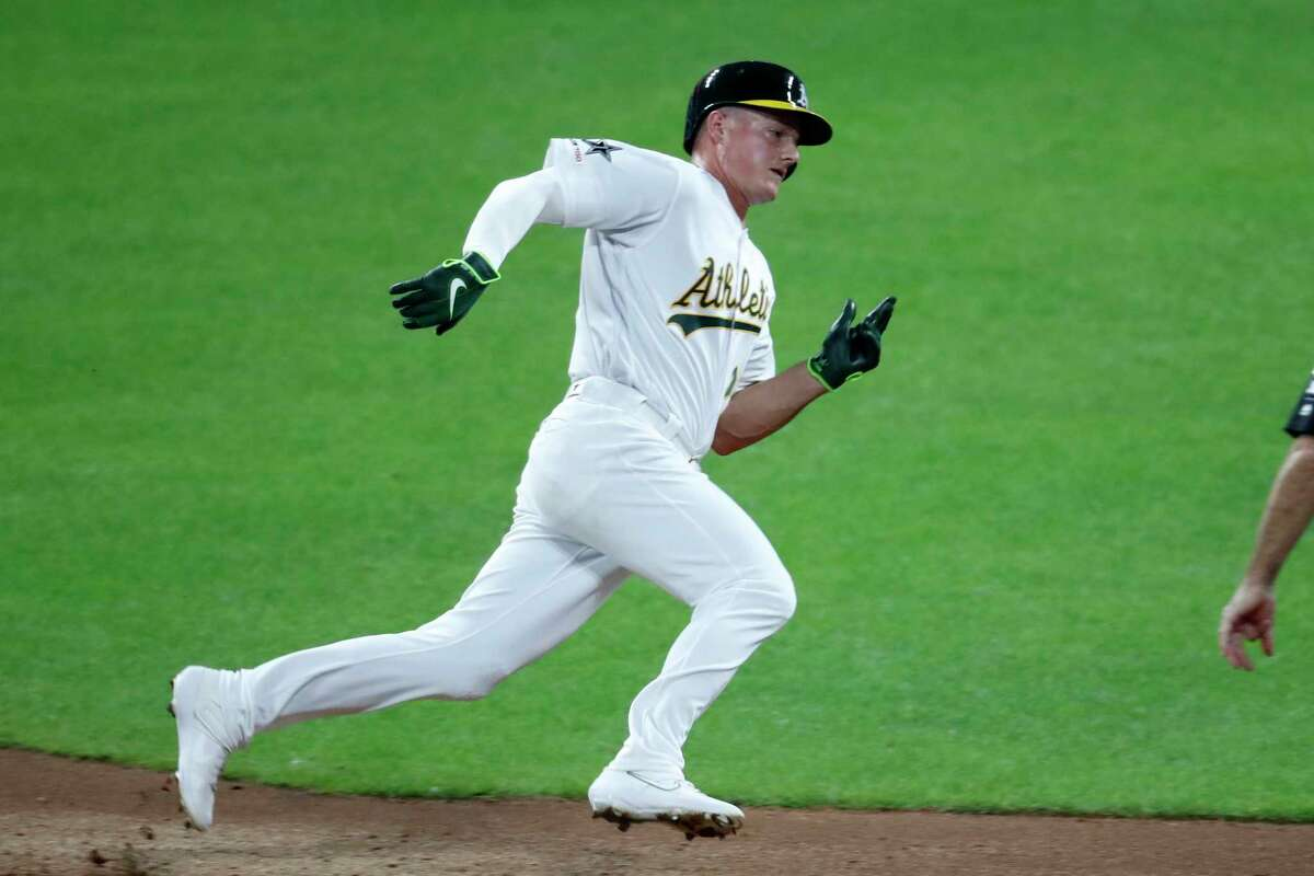 American League Matt Chapman, of the Oakland Athletics, rounds to second on his way to third on a single by American League teammate James McCann, of the Chicago White Sox, during the seventh inning of the MLB baseball All-Star Game against the National League, Tuesday, July 9, 2019, in Cleveland. (AP Photo/Ron Schwane)