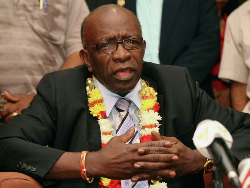 FILE - In this June 2, 2011, file photo, suspended FIFA executive Jack Warner gestures during a news conference at the airport in Port-of-Spain, Trinidad and Tobago. The former Caribbean soccer official has been ordered to pay a $79 million penalty stemming from the FIFA bribery scandal. A federal judge in New York City imposed the judgment against Warner in a lawsuit brought by the Confederation of North, Central American and Caribbean Association Football. (AP Photo/Shirley Bahadur, File)