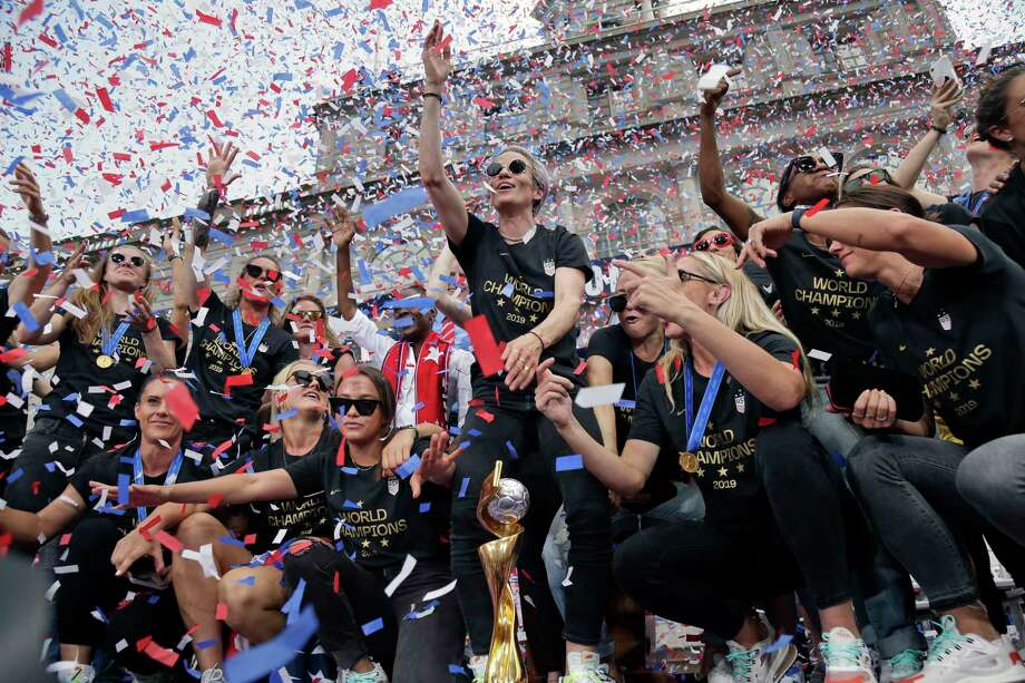 The U.S. women's soccer team, Megan Rapinoe center, celebrates at City Hall after a ticker tape parade, Wednesday, July 10, 2019, in New York. The U.S. national team beat the Netherlands 2-0 to capture a record fourth Women's World Cup title. (AP Photo/Seth Wenig) Photo: Seth Wenig / Copyright 2019 The Associated Press. All rights reserved.