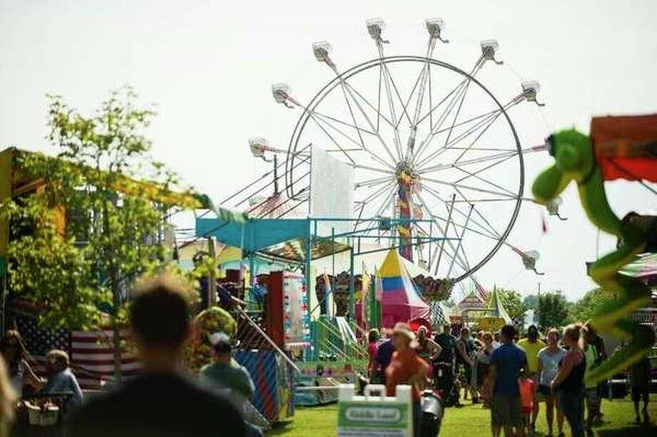 People enjoy rides, games, food and more duringa previous Auburn Cornfest on Thursday, July 6, 2017, in Auburn. (Katy Kildee/kkildee@mdn.net)