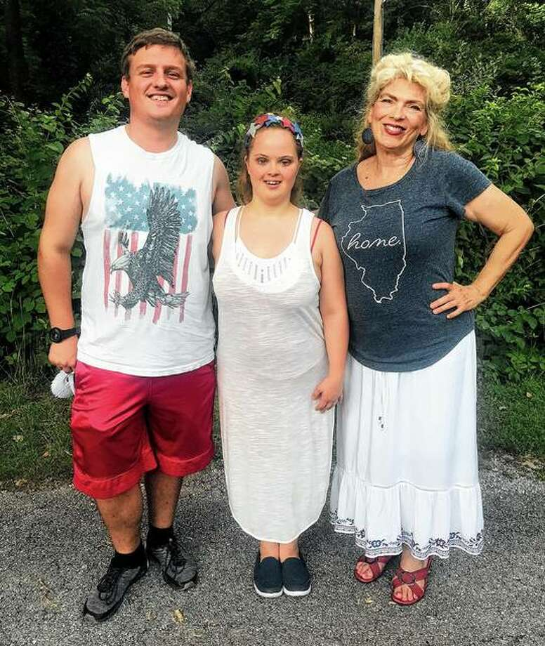 """Marcus Blair (from left), Laura Maruna and Sherri Mitchell, all of Jacksonville, are among the 23-member cast of Theatre in the Park's """"All Shook Up."""" The jukebox musical featuring Elvis Presley hits opens Friday at the theater at Lincoln's New Salem State Historic Site in Petersburg. Photo: Photo Provided"""