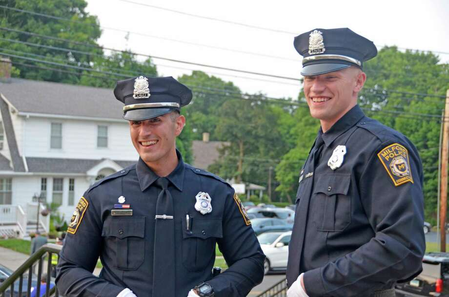 Milford Patrolman Steven Loschiavo, left, with his best friend, Eric Hoff, who graduated from the Milford Police Academy July 10, 2019. Photo: Jill Dion / Hearst Connecticut Media