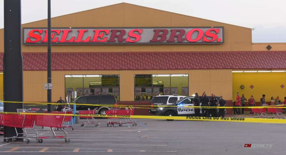 Houston police investigate an incident Wednesday, July 10, involving an off-duty assistant chief from the Bridge City Police Department. The officer was injured when he tried to confront suspected shoplifters, police said. Photo: OnScene TV