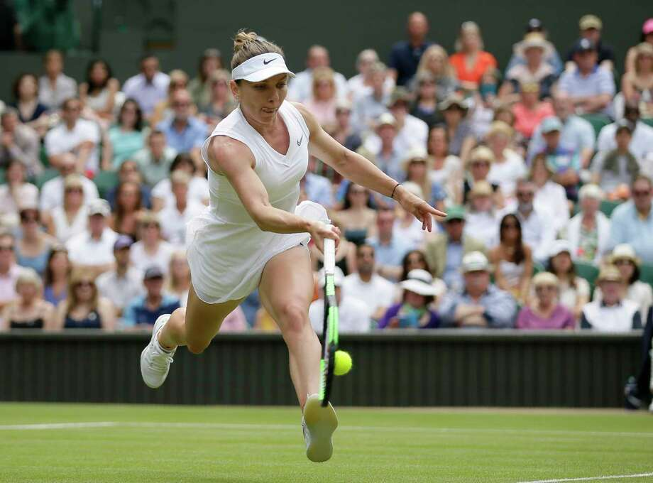Romania's Simona Halep returns the ball to Ukraine's Elina Svitolina during a women's singles semifinal match on day ten of the Wimbledon Tennis Championships in London, Thursday, July 11, 2019. Photo: Tim Ireland, AP / Copyright 2019 The Associated Press. All rights reserved
