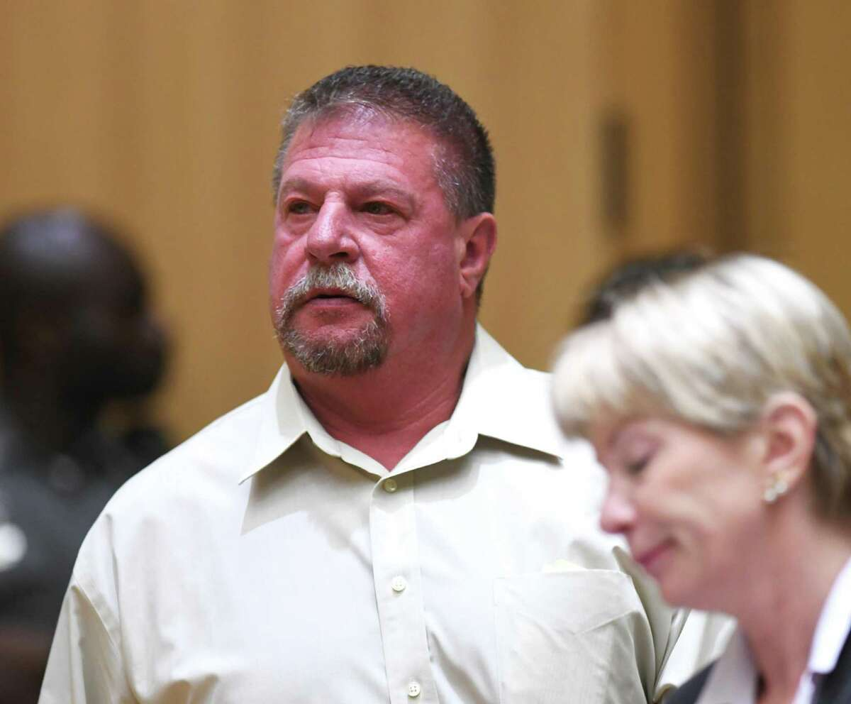 Former Stamford police officer Mark Ligi is arraigned and accompanied by his attorney, Sharen Friday, for a first-degree larceny charge at the Connecticut Superior Court in Stamford, Conn. Monday, June 24, 2019. Former Stamford police officers Chris Broems, Mark Ligi, Paul Pavia and Dave Sileo were arraigned Monday on first-degree larceny charges for allegedly submitting 643 false payroll vouchers totaling $187,618.