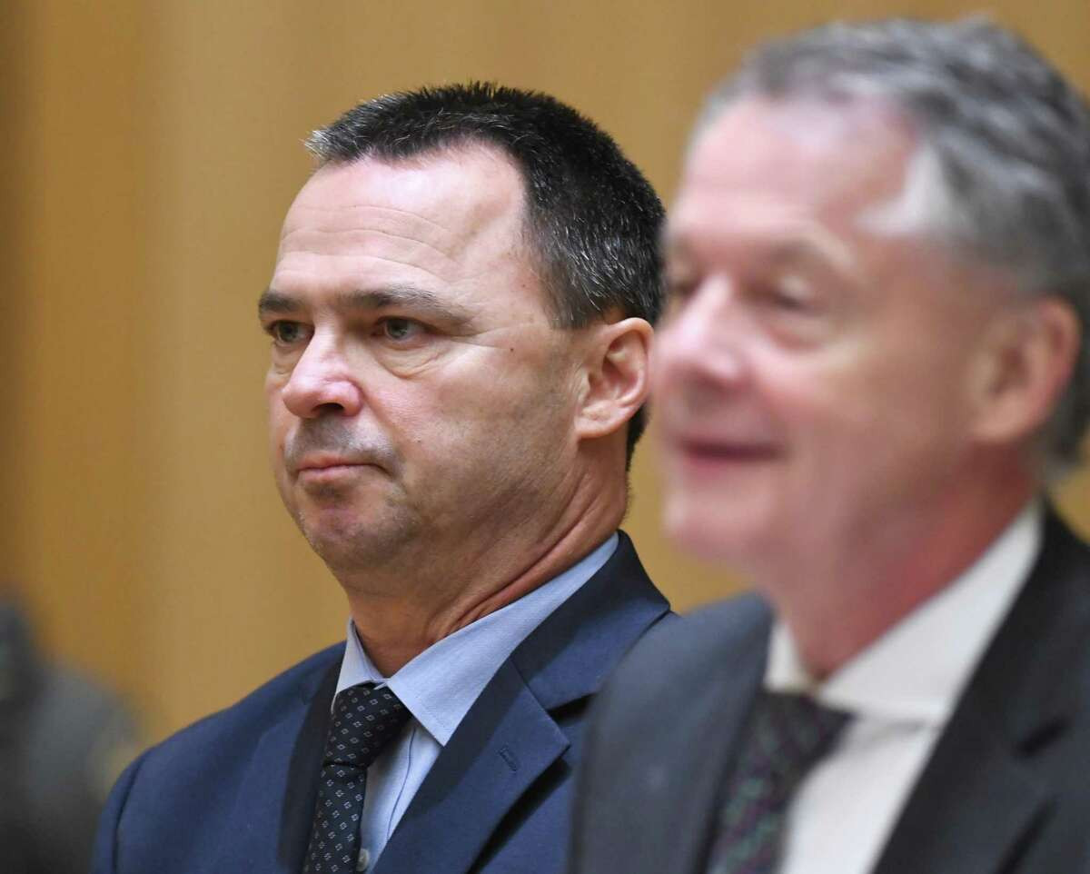 Former Stamford police officer David Silvio, left, is arraigned and accompanied by his attorney, John Gulash, for a first-degree larceny charge at the Connecticut Superior Court in Stamford, Conn. Monday, June 24, 2019. Former Stamford police officers Chris Broems, Mark Ligi, Paul Pavia and Dave Sileo were arraigned Monday on first-degree larceny charges for allegedly submitting 643 false payroll vouchers totaling $187,618.