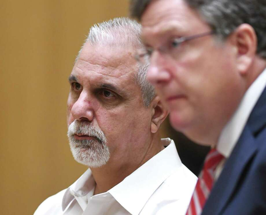 Former Stamford police officer Paul Pavia, left, is arraigned and accompanied by his attorney, Francis O'Reilly, for a first-degree larceny charge at the Connecticut Superior Court in Stamford, Conn. Monday, June 24, 2019. Former Stamford police officers Chris Broems, Mark Ligi, Pavia and Dave Sileo were arraigned Monday on first-degree larceny charges for allegedly submitting 643 false payroll vouchers totaling $187,618. Photo: Tyler Sizemore / Hearst Connecticut Media / Greenwich Time