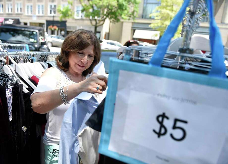 Margarita Guiterrez of Mamaroneck, N.Y. browses sale items in July 2018 at the annual Sidewalk Sale Days promotion in Greenwich, Conn. Photo: Tyler Sizemore / Hearst Connecticut Media / Greenwich Time