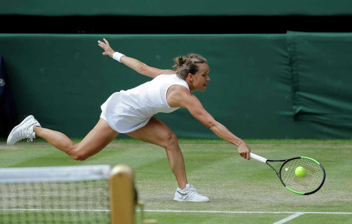 Czech Republic's Barbora Strycova returns to United States' Serena Williams in a Women's semifinal singles match on day ten of the Wimbledon Tennis Championships in London, Thursday, July 11, 2019.