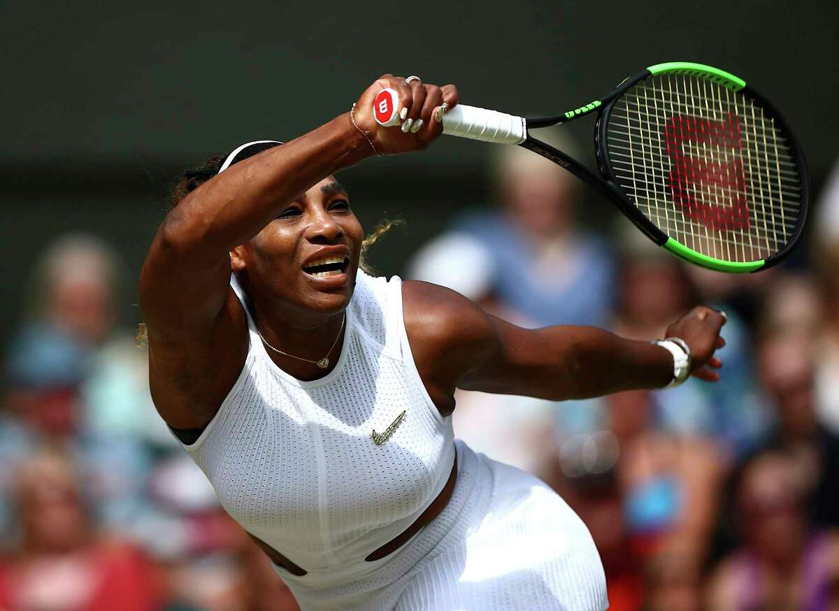 United States' Serena Williams returns to Czech Republic's Barbora Strycova in a Women's semifinal singles match on day ten of the Wimbledon Tennis Championships in London, Thursday, July 11, 2019. (Hannah McKay/Pool Photo via AP)