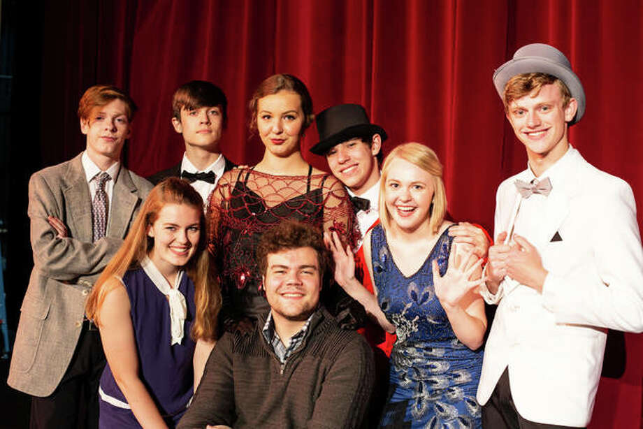 "Alaina Bozarth (as Janet), front row, from left, Jayson Heil (Man in Chair), Shelby Oertel (Kitty), Gabe Levi (Robert), and back row, Austin Turnbull (George), Lorian Warford (underling), Audrey Neace (The Drowsy Dhaperone), and Garrett Cooper (Feldzieg) will appear in ""The Drowsy Chaperone,"" July 19, 20, 21 in the Alton High School auditorium. Photo: Michael Frazier 