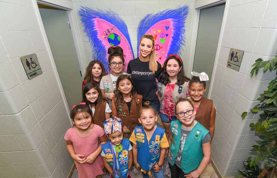Miss Laredo Chelsea Morgensen poses for a photo with members of the Girl Scouts of South Texas Brownie Troop 9179 after completing a mural for The Thumper Project on Tuesday at the Laredo Service Center. Photo: Danny Zaragoza/Laredo Morning Times