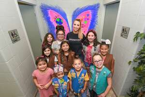 Miss Laredo Chelsea Morgensen poses for a photo with members of the Girl Scouts of South Texas Brownie Troop 9179 after completing a mural for The Thumper Project on Tuesday at the Laredo Service Center.