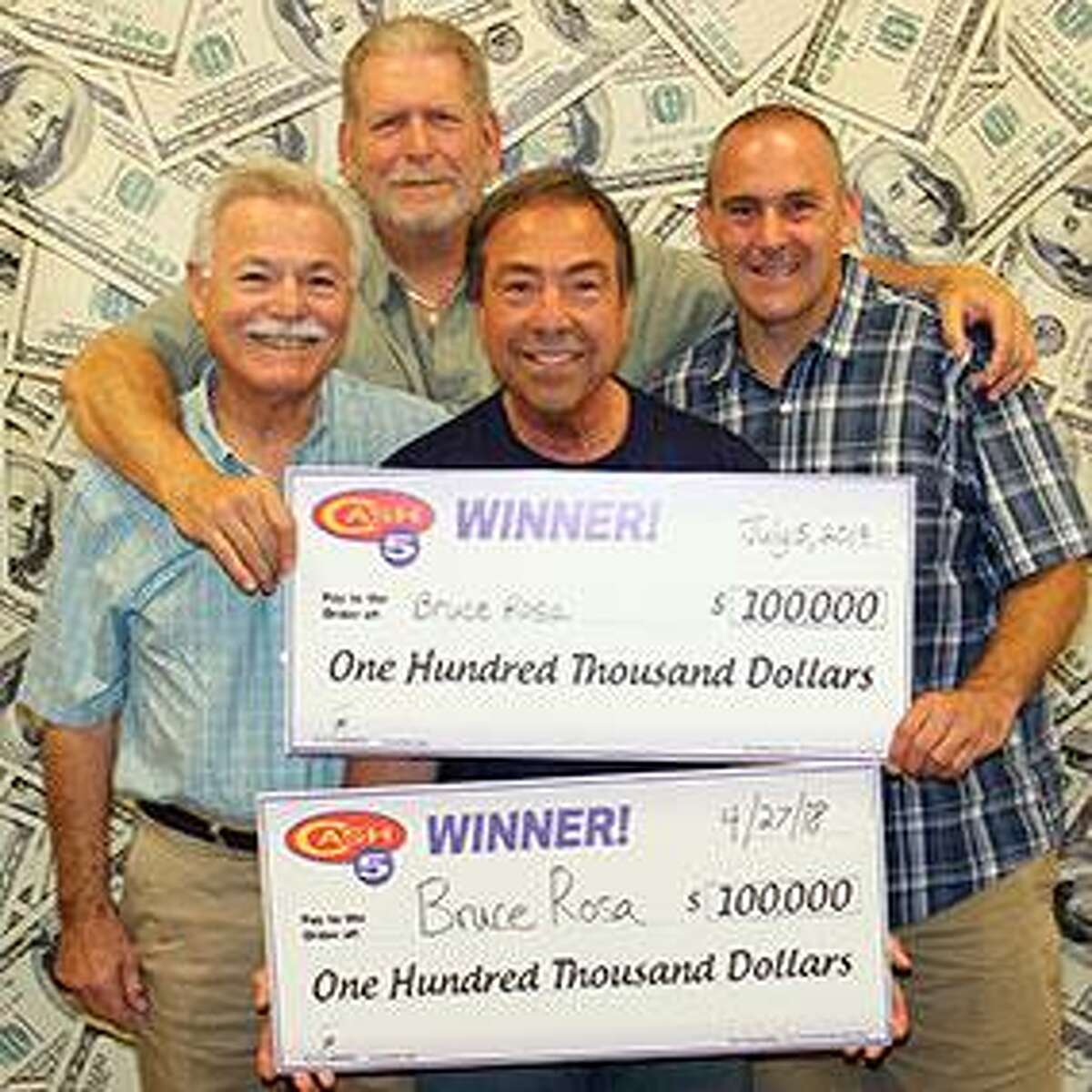 Bruce Rosa poses with his winnings, two friends and his son-in-law on Tuesday, July 9, 2019.