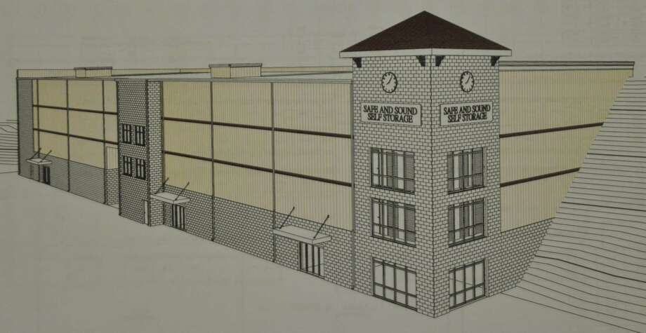 The self storage facility proposed for 800 Danbury Road would be set into the hillside. Pending revisions suggested by Architectural Advisory Committee include roofs over the two towers at center and far left, as at right, and a change of materials above the first floor. Photo: Design By Storage Structure Of Villa Rica, Ga.
