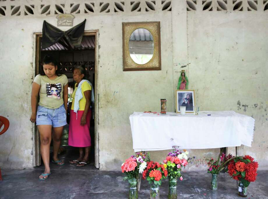 Yossely Miranda, the 16-year-old sister of Juana Anastasia, walks by a small shrine to her young sister who died near McAllen after crossing the Rio Grande. Yossely had stayed behind in Valle Lirio, Guatemala. Photo: Bob Owen / ©2019 San Antonio Express-News