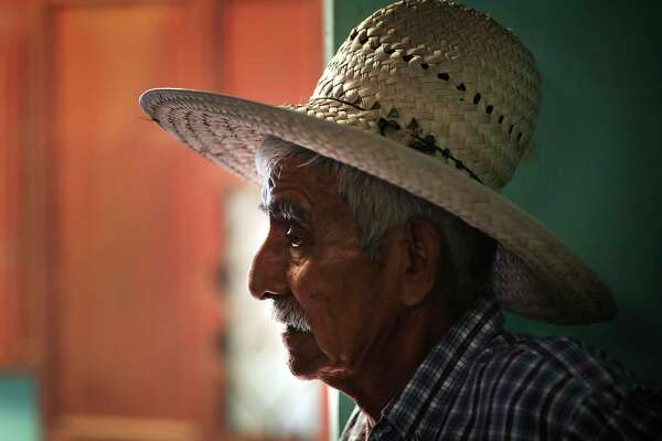 Faustino Javier Recinos, 70, grandfather of Denilson Recinos, visits the room in Chiquirines, Guatemala, where Denilson and Briseyda Chicas lived with their children.