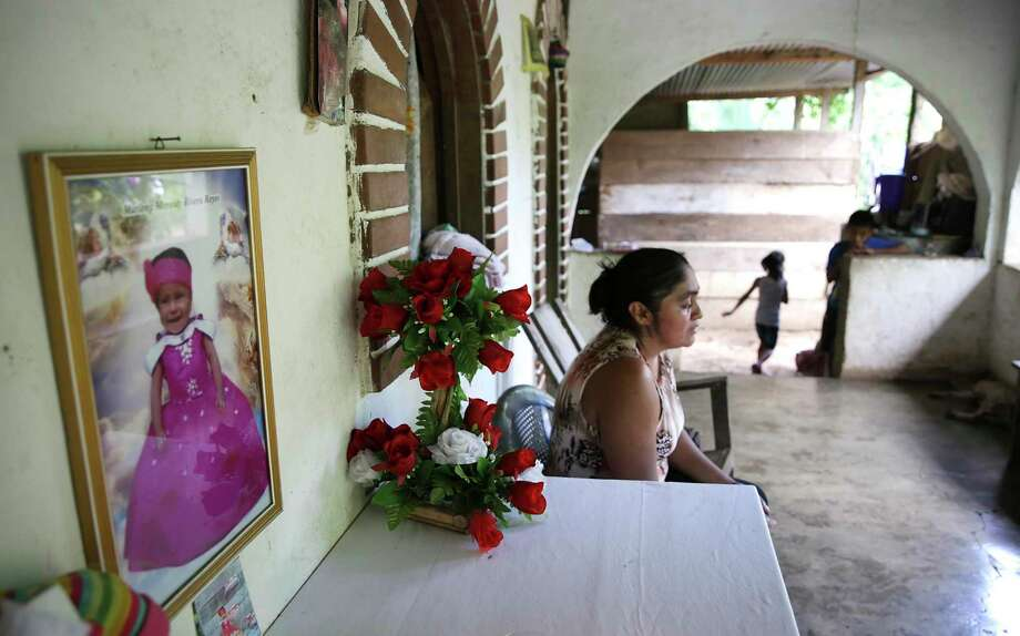 Amelia Sopón, 42, grandmother of Marleny, grieves the death of her granddaughter beside a small shrine at her home in El Reparo, Guatemala. Photo: Bob Owen /Staff Photographer / ©2019 San Antonio Express-News