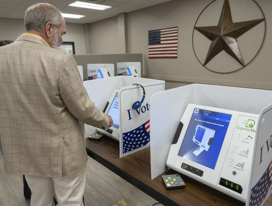 Midland County Judge Terry Johnson tries out the new voting machines 07/11/19 at the Midland County Election Office. Tim Fischer/Reporter-Telegram Photo: Tim Fischer/Midland Reporter-Telegram
