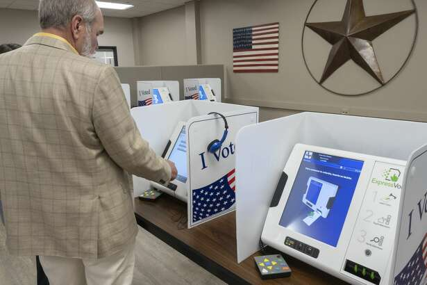Midland County Judge Terry Johnson tries out the new voting machines 07/11/19 at the Midland County Election Office. Tim Fischer/Reporter-Telegram