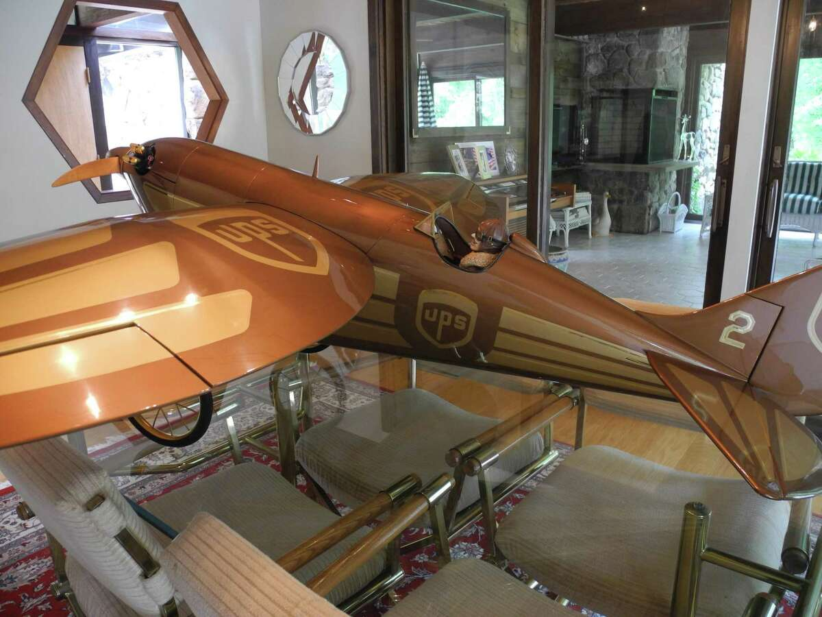 This remote-controlled airplane rests on the Stilleys' dining room table.