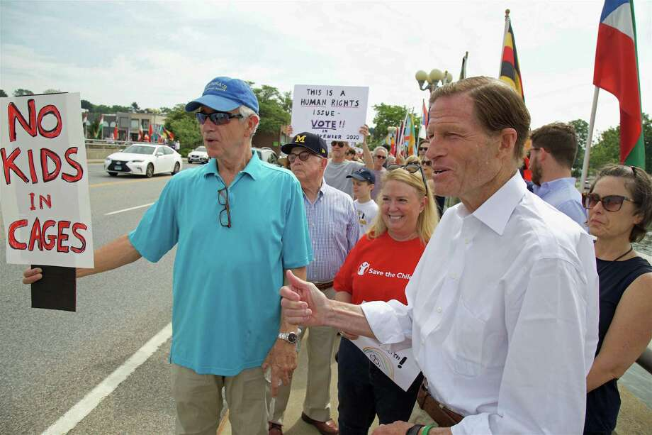 Performer and Weston resident James Naughon, left, and U.S. Sen. Richard Blumenthal, at the protest against U.S. detention centers on the Ruth Steinkraus Cohen Bridge Saturday, June 29, 2019, in Westport, Conn. Photo: Jarret Liotta / For Hearst Connecticut Media / Westport News Freelance