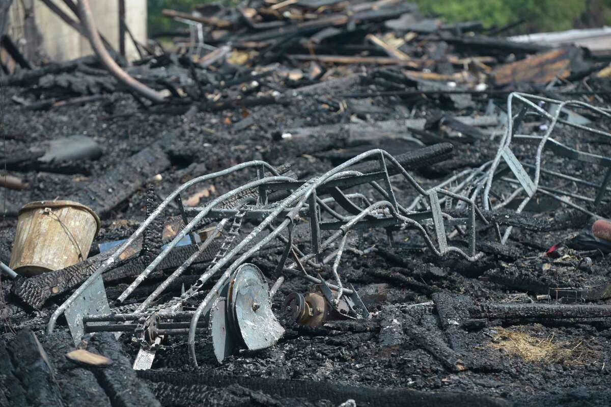 An early morning fire destroyed a barn at Long Meadow Horse Farm in Newtown Thursday. The farm is 30-acre horse boarding stable located at 34 Meadowbrook Road. Thursday, July 11, 2019, in Newtown, Conn.