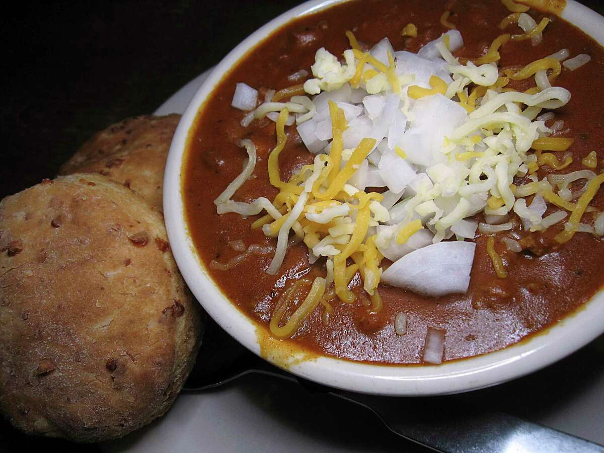 Beef and bean chili is dressed with onions and cheese at Tejas Steakhouse & Saloon.