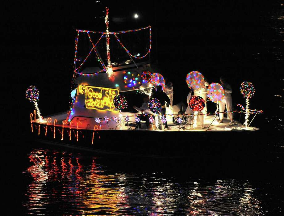 Brad Horrigan | New Haven Register. BH0674. Stratford, Connecticut - 09.18.10: The Good Ship Lollipop boat in Saturday night's Riverlight Boat Parade.