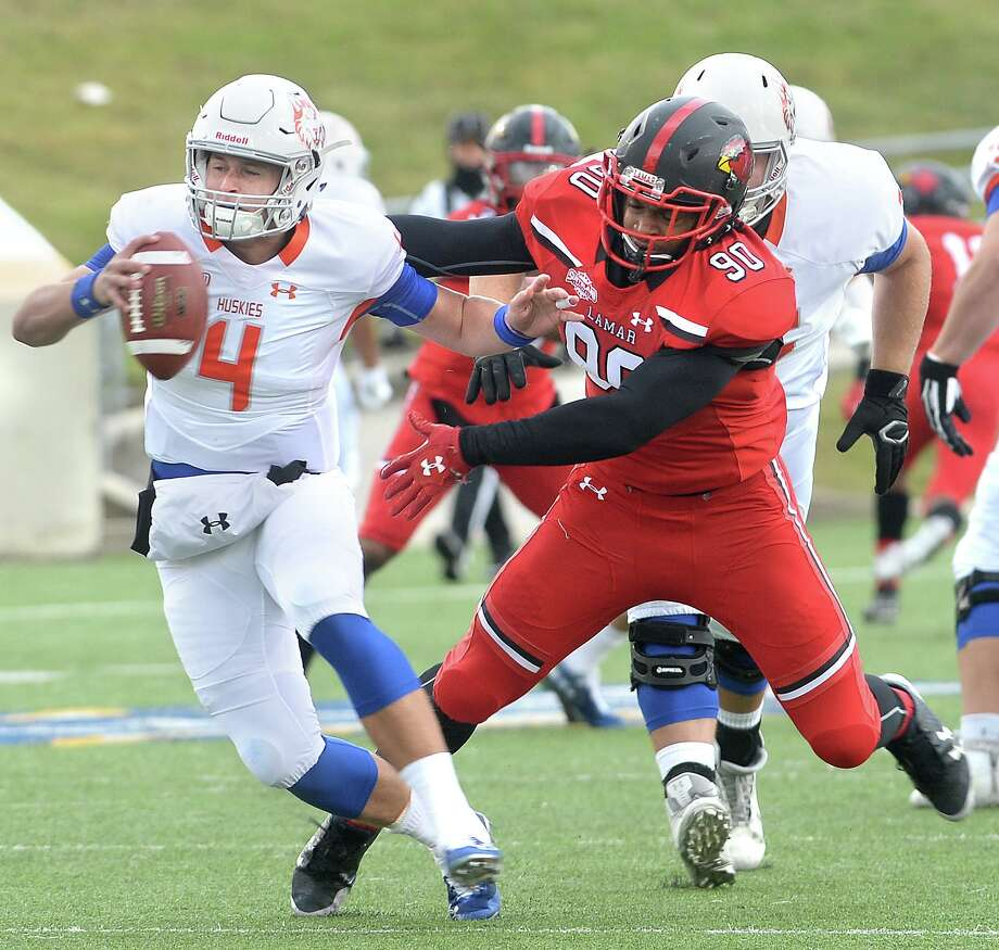 Lamar's Daniel Crosley goes for the tackle against Houston Baptist quarterback Bailey Zappe during the Cardinals' final home game of the season Saturday.  Photo taken Saturday, November 10, 2018  Kim Brent/The Enterprise Photo: Kim Brent / The Enterprise / BEN