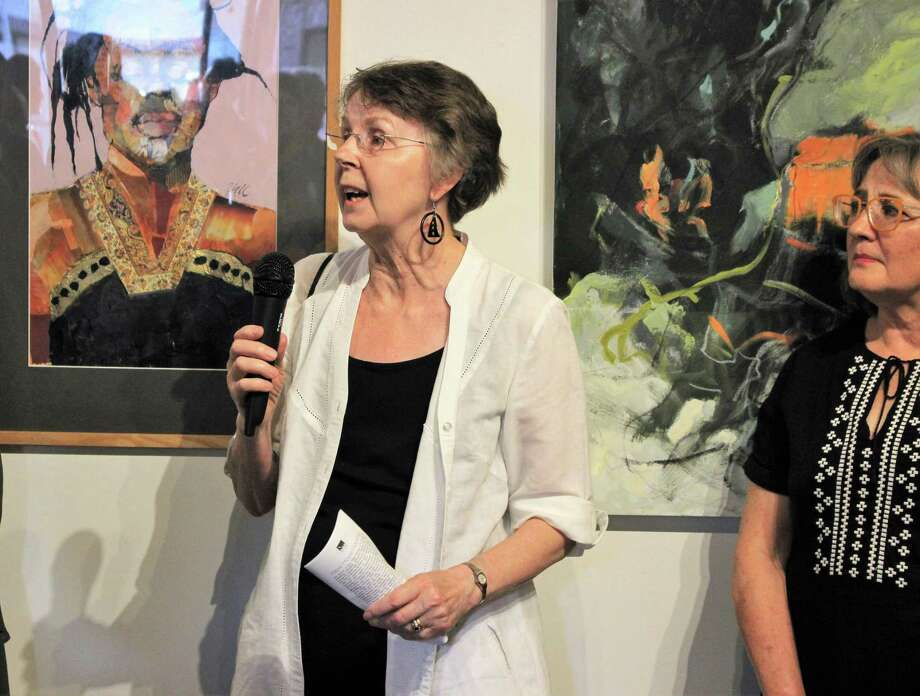 "Juror Penny Cerling, left, addresses the crowd while artist Liz Hill stands by at the 11th Annual Archway Gallery Juried Art Show. Hill's work ""Respite"" took home an honorable mention award. Photo: Courtesy Photo"