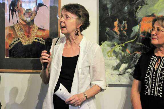"""Juror Penny Cerling, left, addresses the crowd while artist Liz Hill stands by at the 11th Annual Archway Gallery Juried Art Show. Hill's work """"Respite"""" took home an honorable mention award."""