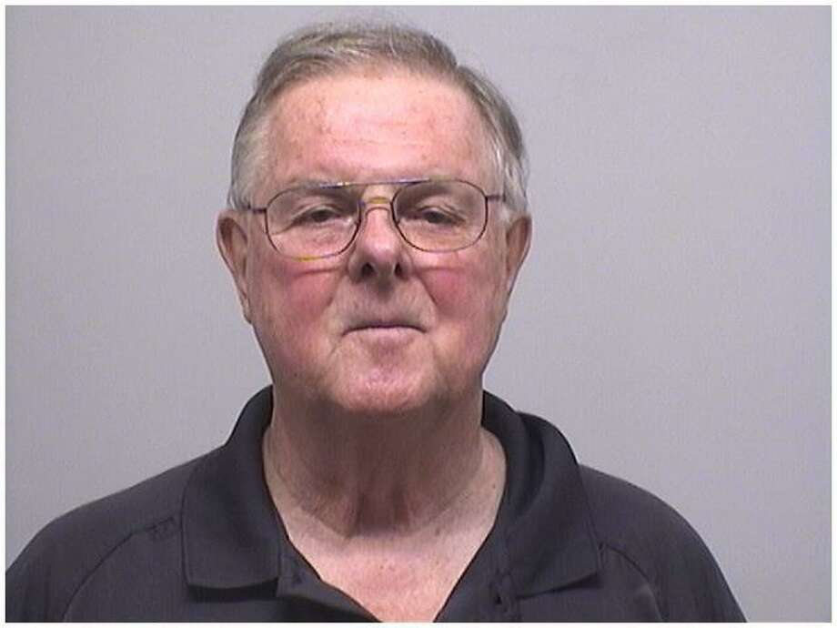 Ridgely Brown, 72, was arrested by police for failing to report to authorities that six of his pistols had been stolen last year. One of the guns turned up on a man who tried to shoot a Stamford narcotics officer on Seaton Road on Tuesday night. Photo: Stamford Police Department / Contributed